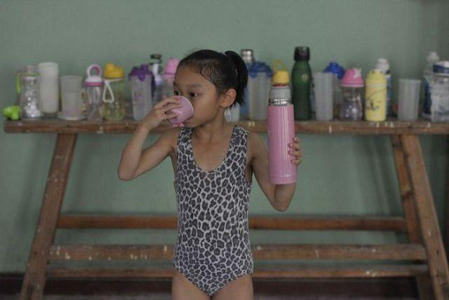 الصين وكيفية صناعة الأبطال الألومبيين China-gymnasium-Olympic-children-34