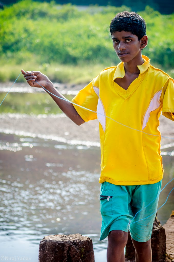 travel photography boy fishing in konkan, budgetyatri