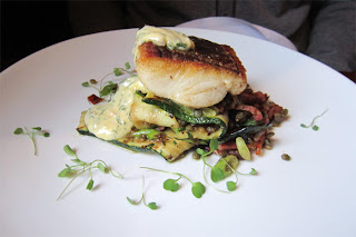 Beautiful hake on courgettes, Puy lentils & pancetta.