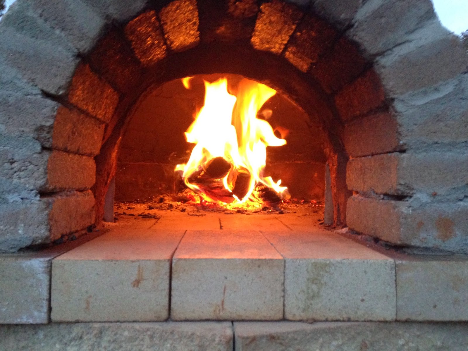 our garden and table n at building and enjoying a wood fired clay oven