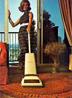 1960s image of woman vaccuming