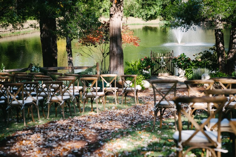 wedding ceremony with leaf and mulch aisle and tuscan cafe chairs