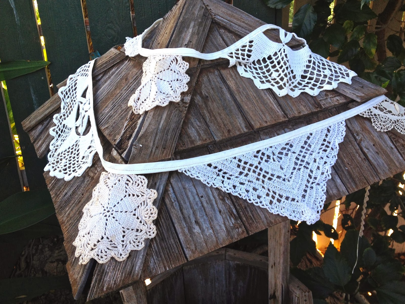vintage doily bunting on a well