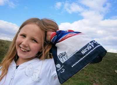 girl showing her support to olympic team gb  next scraf