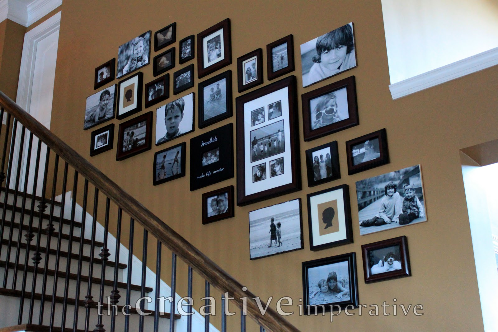 the creative imperative: stairway gallery wall
