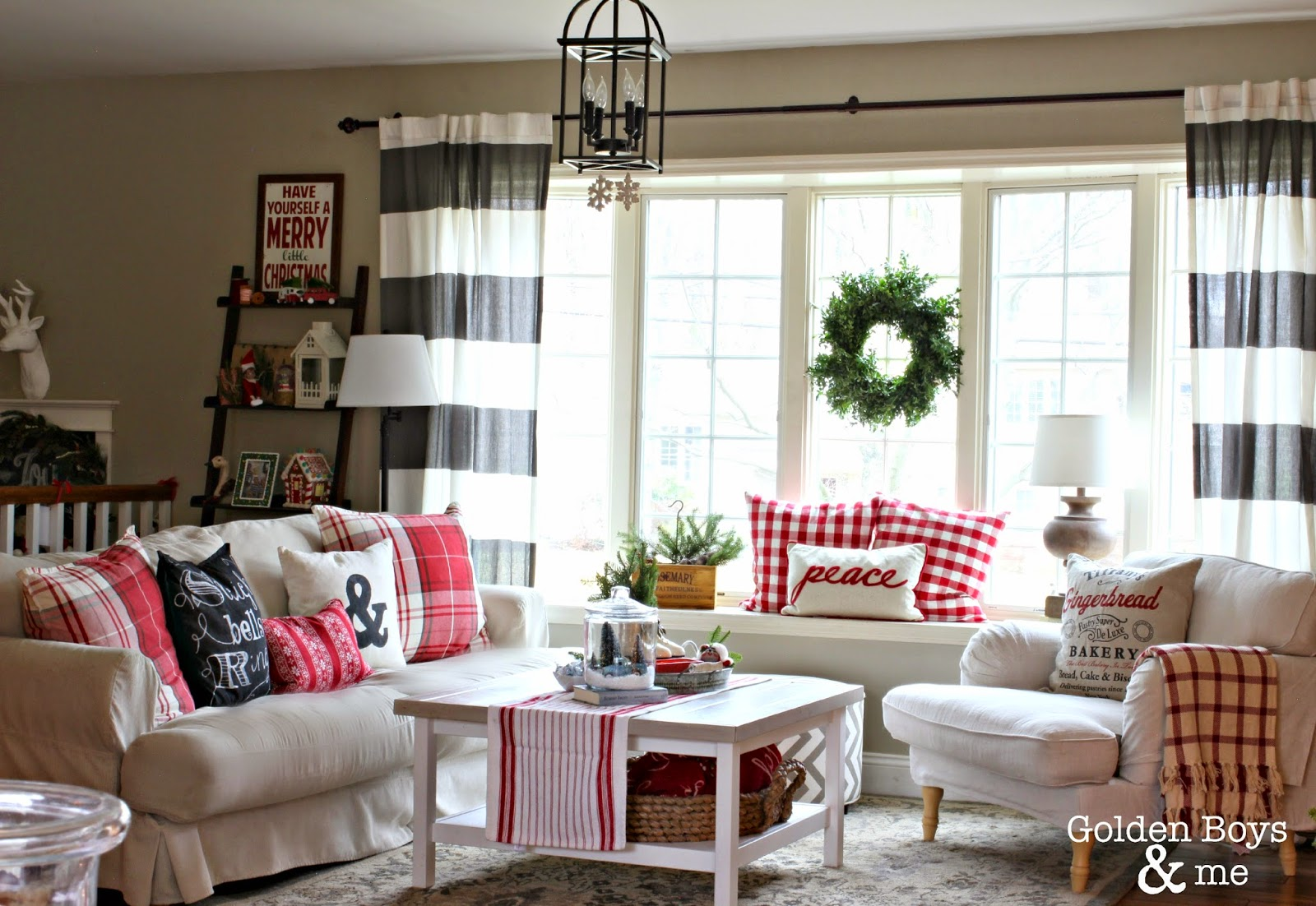 Christmas living room with Ikea Stocksund chair, striped drapes and Ikea hack Hemnes coffee table-www.goldenboysandme.com
