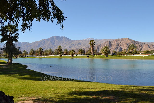 A lake covers part of the grounds between polo fields