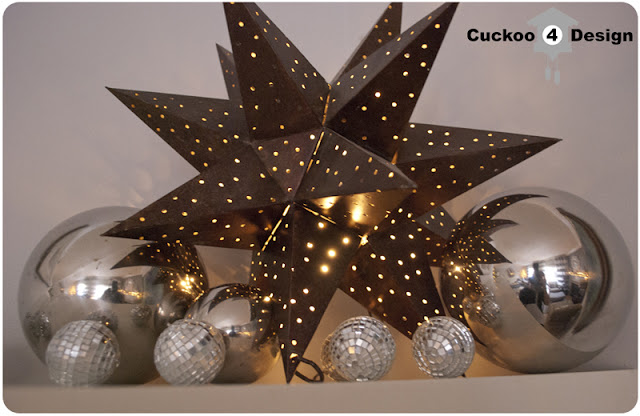 brown moravian star, silver globes and disco balls
