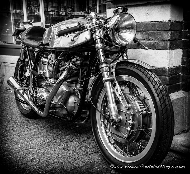 A chance encounter with a man sitting on a tiny little stool cleaning his Triumph motorcycle on a lazy Sunday afternoon on the Kleine Berg in Eindhoven, a small narrow street with an abundance of cafes and restaurants which gives a very charm...