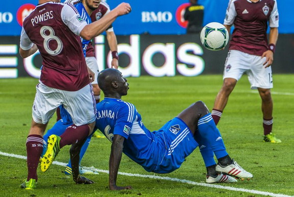 Montreal Impact player Hassoun Camara scores from a semi-bicycle kick against Colorado Rapids