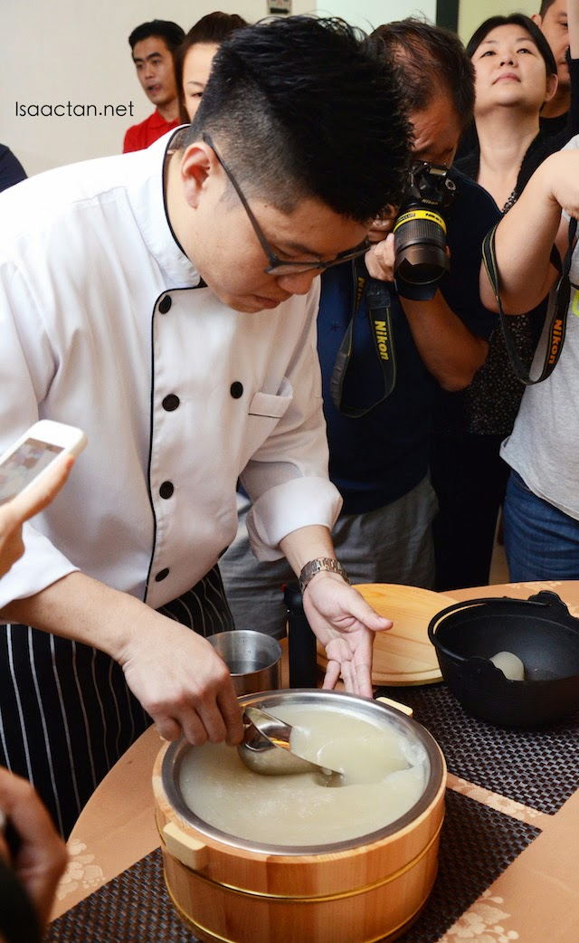 The chef scooping up fresh collagen from the pot into our steamboat bowls.