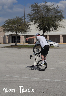 Guy Riding on One Wheel of Bike