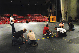 Stage managers marking-up a stage