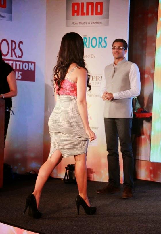 sana khan latest hot spicy stills at society interior