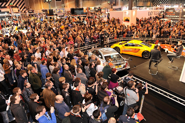 Crowds surround the Autosport Stage at Autosport International 2012