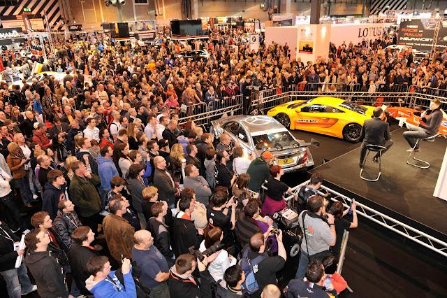 Crowds surround the Autosport Stage at Autosport International 2012