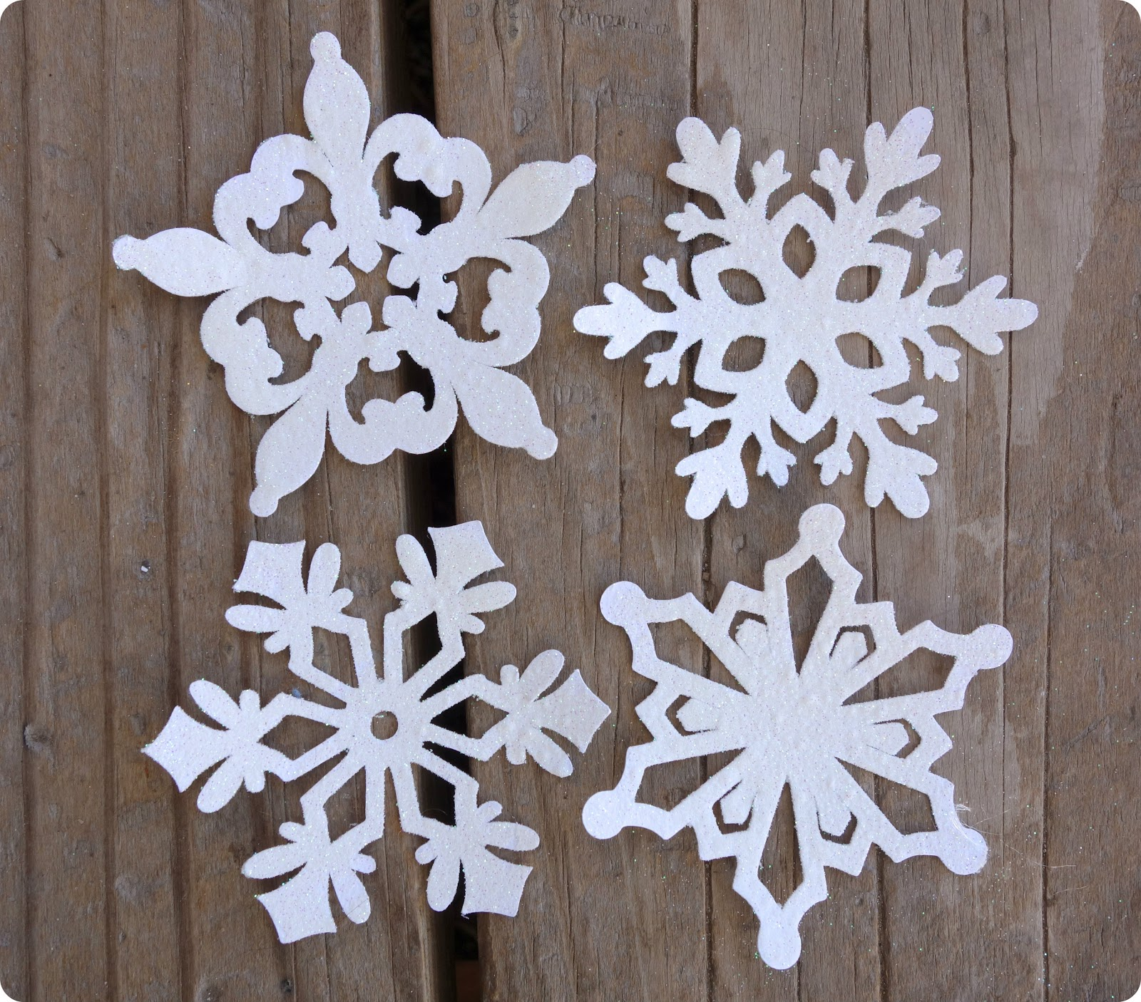 Make snowflake ornaments - I Also Use My Winter Lace Cartridge To Make Some White Snowflakes I Cut Out The Snowflakes Sprayed Them With Spray Adhesive And Then Sprinkled Them With