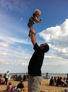 Daddy throwing Eliza in the air
