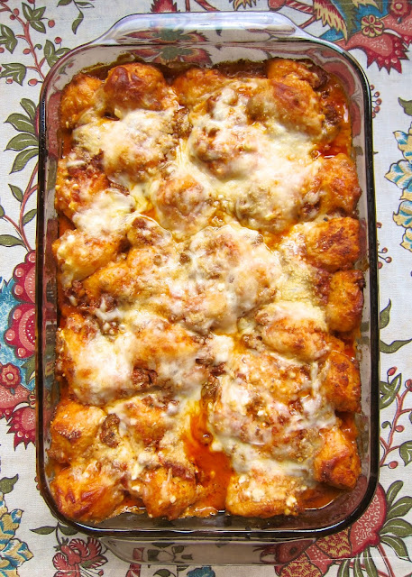 Bubble Up Lasagna - Italian sausage, spaghetti sauce, 3 cheeses tossed with chopped refrigerated biscuits - all the flavors of lasagna without all the work! I literally wanted to lick my plate! Precook the sausage and this dish is ready before the oven can preheat!
