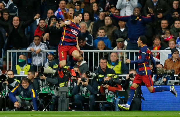 Jump for joy: Luis Suarez celebrates
