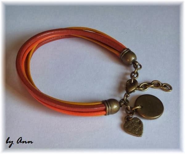 bransoletka pomarańczowa żółta elementy pozłacane rzemykowa