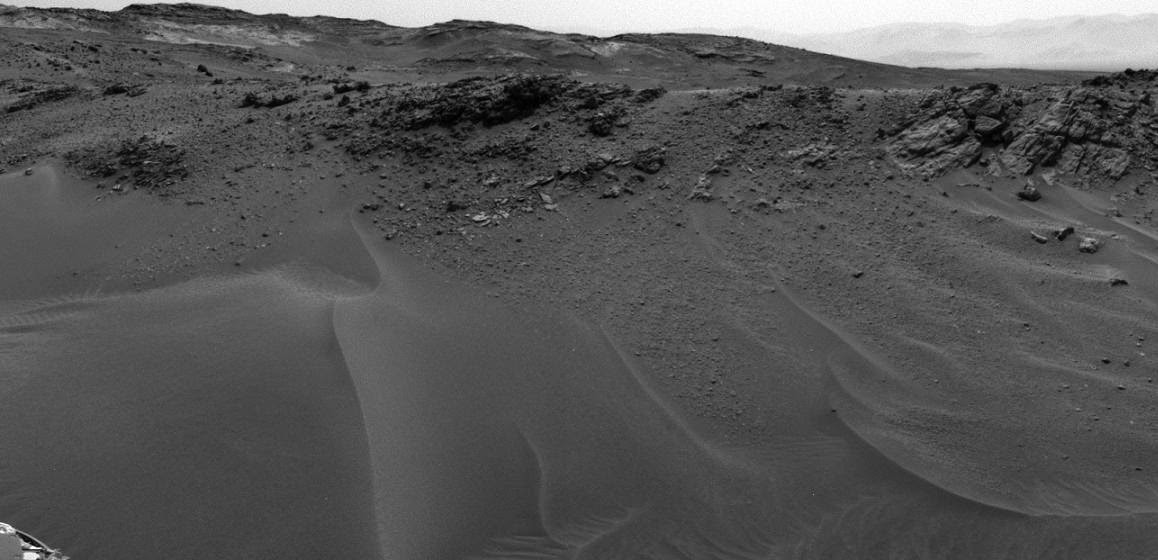 NASA's Curiosity Mars rover used its Navigation Camera (Navcam) to capture this scene toward the west just after completing a drive that took the mission's total driving distance on Mars past 10 kilometers (6.214 miles). Credits: NASA/JPL-Caltech