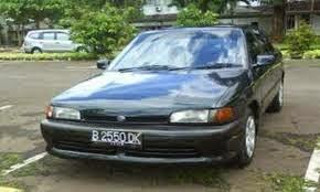gambar mobil mazda astina hitam