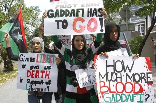 Egyptian stories is the game over for gaddafi libyans living in malaysia shout slogans and hold placards in protest of libyan leader muammar gaddafi during a demonstration outside libyas embassy in sciox Choice Image