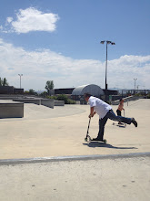 Scott riding a scooter at the skatepark