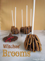 brownie bites on sticks decorated like brooms