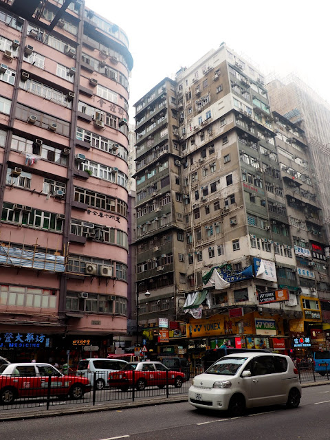 Skyscrapers in the streets of Mong Kok, Kowloon, Hong Kong