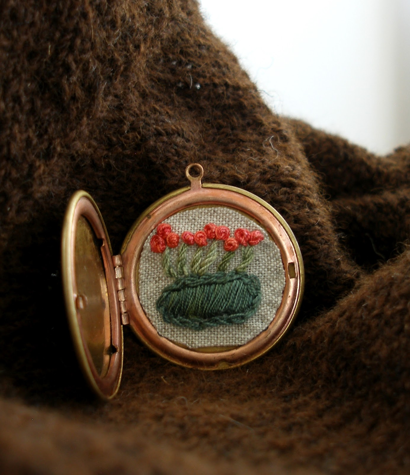 The knitting by mr puffy dog embroidered locket