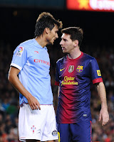Lionel Messi of FC Barcelona (R) argues with Jonathan Vila of RC Celta de Vigo during the La Liga match between FC Barcelona and RC Celta de Vigo at Camp Nou