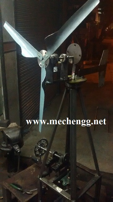 WATER PUMPING SYSTEM AND POWER GENERATION BY USING WIND POWER AND PEDAL POWER.