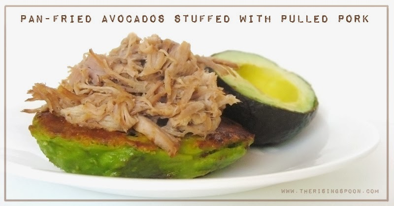 Pulled Pork Stuffed Avocado Halves | www.therisingspoon.com #paleo #primal #lowcarb