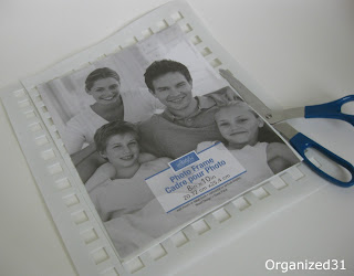 picture frame insert on top of white mat and scissors cutting