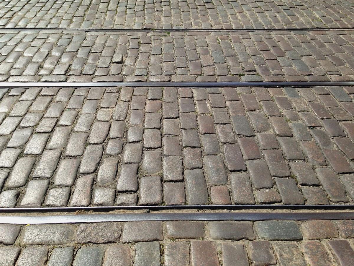 Tram Tracks and Cobblestones in Chlodna St. by Maja Trochimczyk