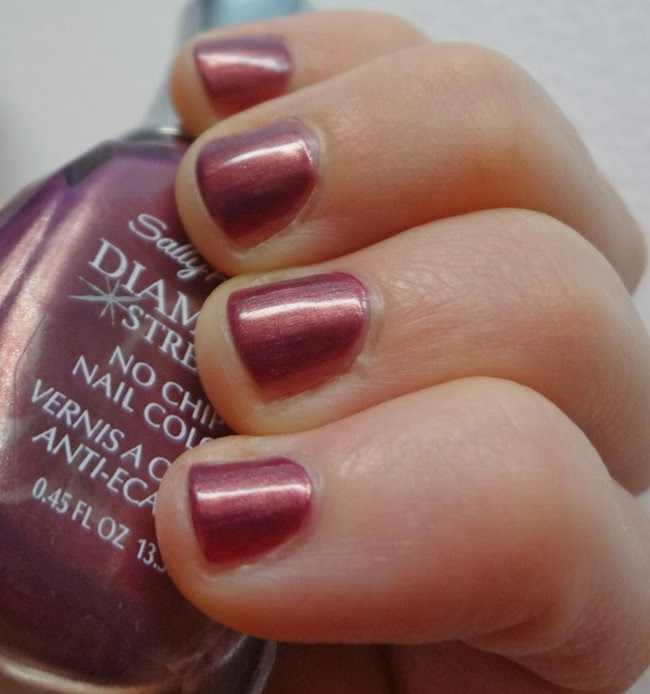 Royal Romance by Sally Hansen, a dark Radiant Orchid nail polish