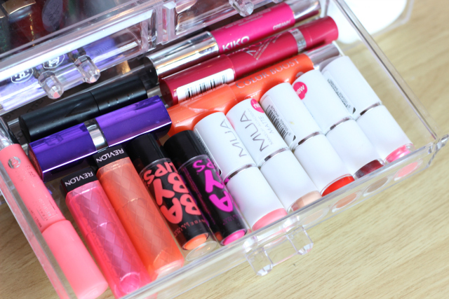 lipsticks in acrylic makeup drawers