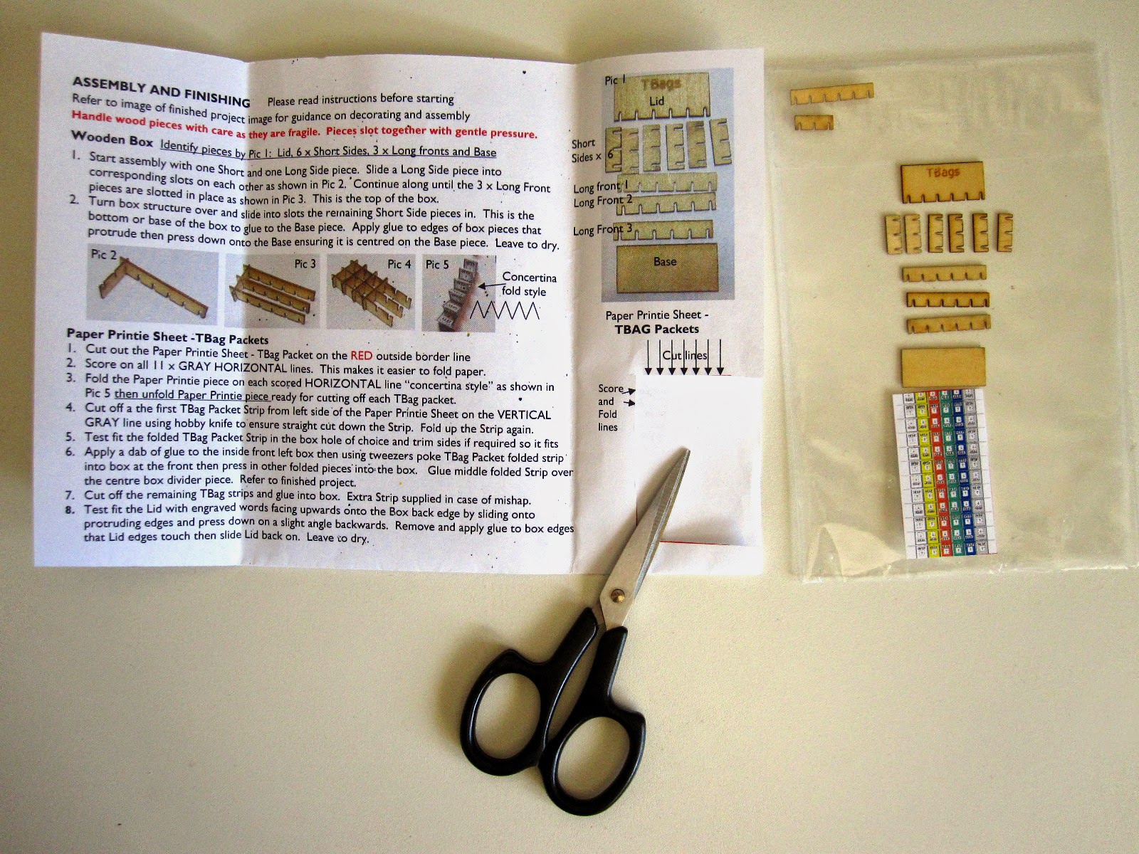 Modern dolls' house miniature tea bag box kit, laid out ready for assembly.