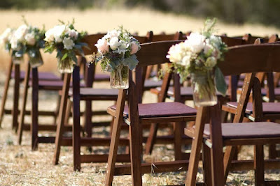 outdoor wedding decorated with white flowers