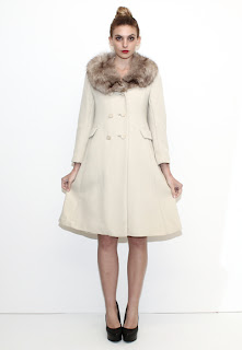 Vintage ivory wool princess coat with brown fox fur collar.