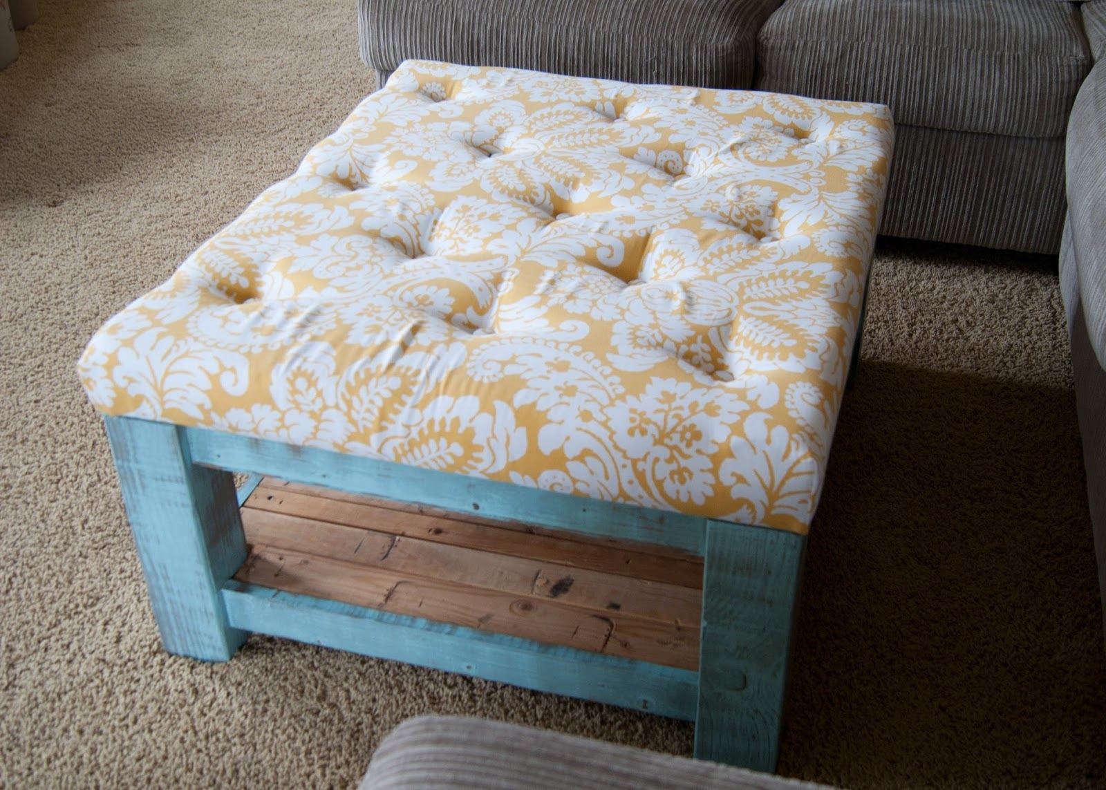 Turquoise ottoman with tufted cushion