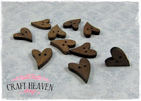 http://www.craftheaven-shop.com/metal-and-other-embellishments/wooden-heart-buttons.html
