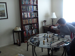 James pondering what he's gonna do in our Marvel Heroclix game.