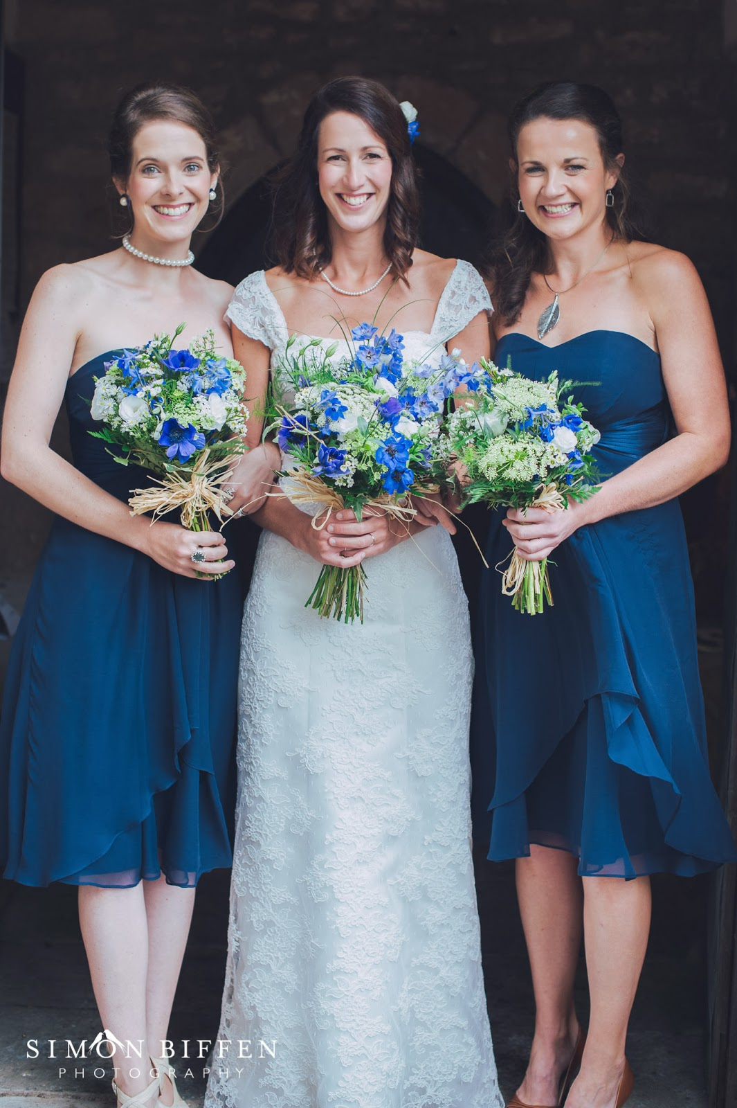 Bride with her bridesmaids in blue dresses