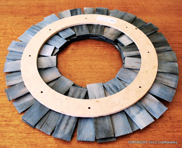 Craftiments:  Wood shim wreath back