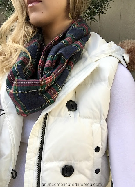 Layers keep you the perfect temerature all winter long. Long sleeved tee shirt, down vest, wool infinity scarf