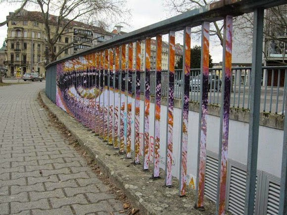 الفن الخفـــي على الـــاسوار Hidden-Street-Art-on-Railings-by-Zebrating-01.jpg