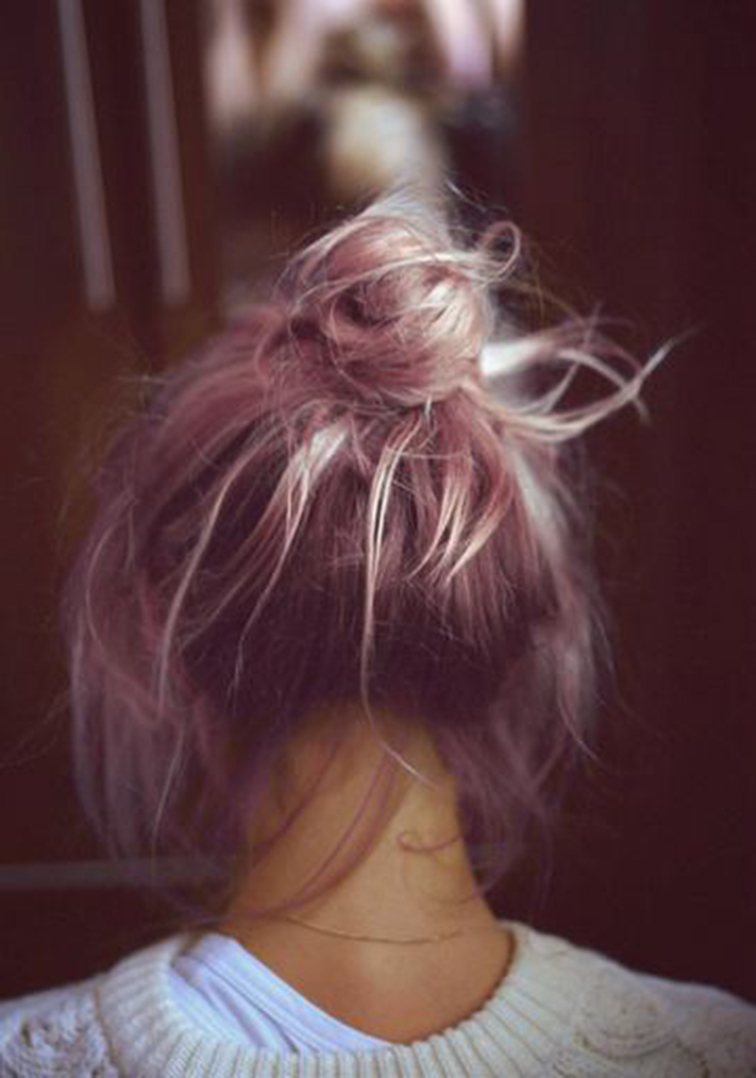 Faded pastel pink messy top knot bun